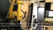 Automated changing of clamping head and workpiece ens-stop