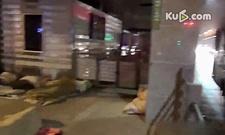 实拍 7名民工为省钱寒夜蜗居10平米公交站